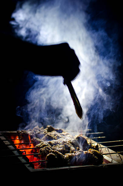 Cooking Smoky &  Spicy beef barbecue in coal fire stock photo