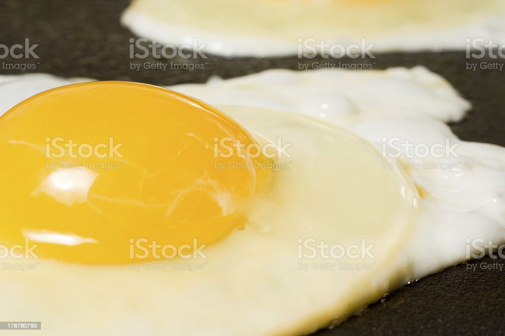 Cooking some Fried Eggs stock photo