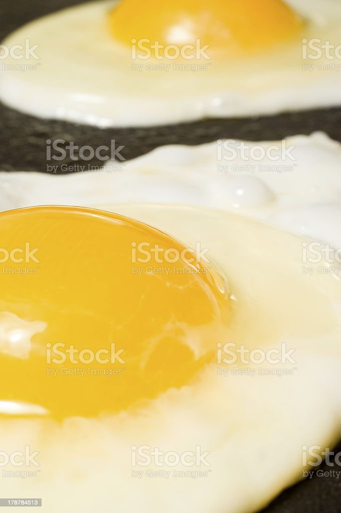 Cooking some fried eggs. stock photo