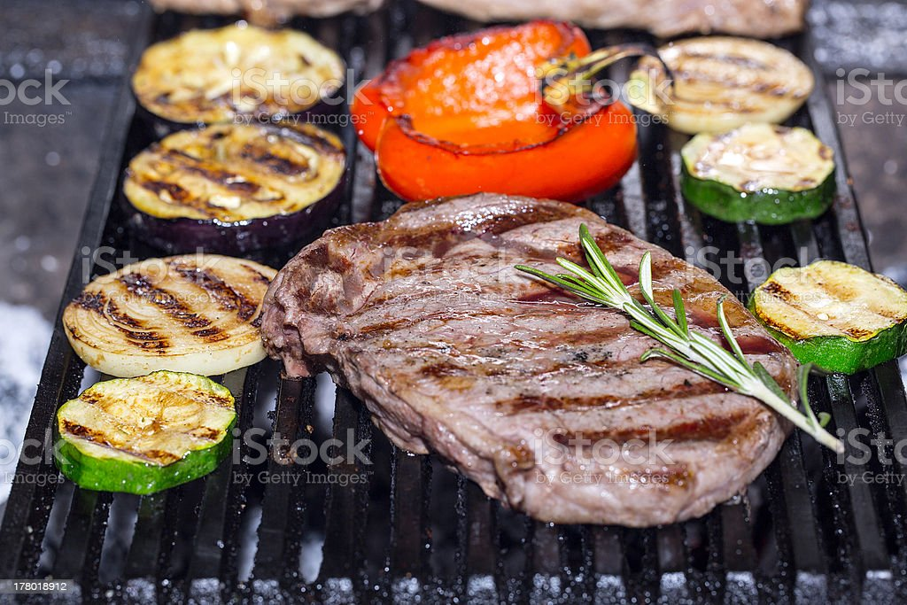 cooking steak with grilled vegetables royalty-free stock photo