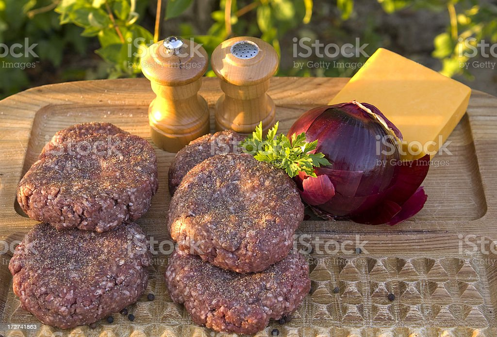 Cooking Summer Hamburgers; Preparing Cheese Burgers for Barbeque Grill royalty-free stock photo