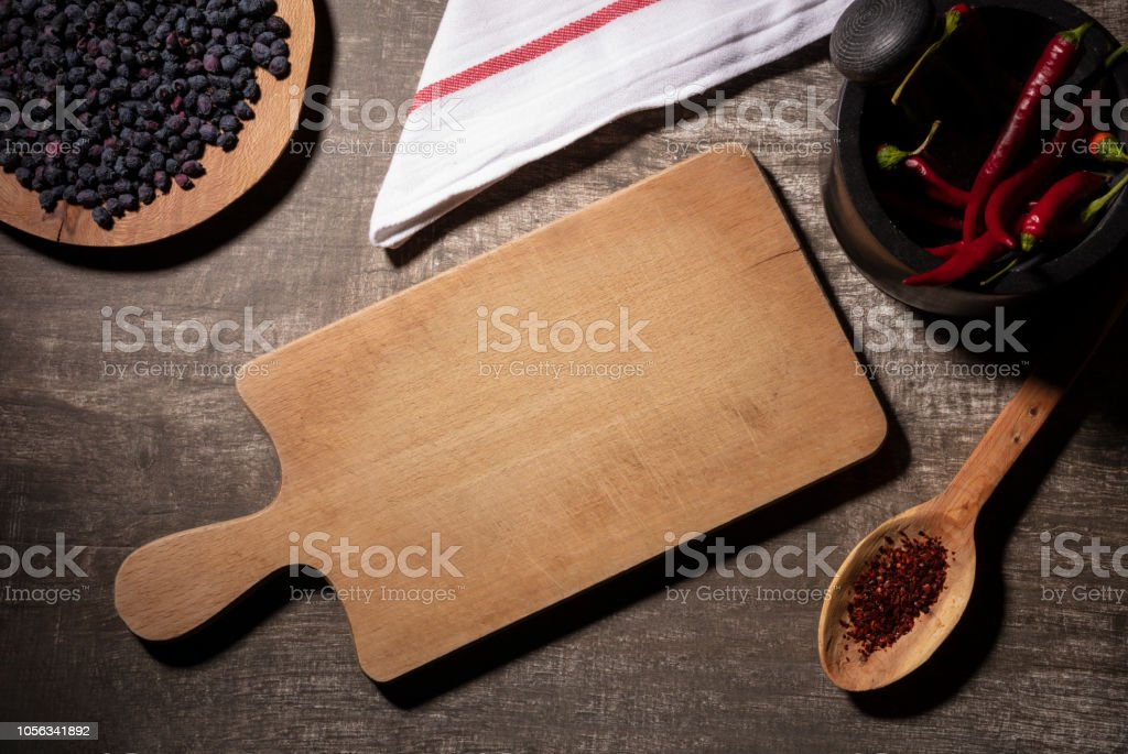 Cooking Table with Herbs, Spices and Utensils stock photo