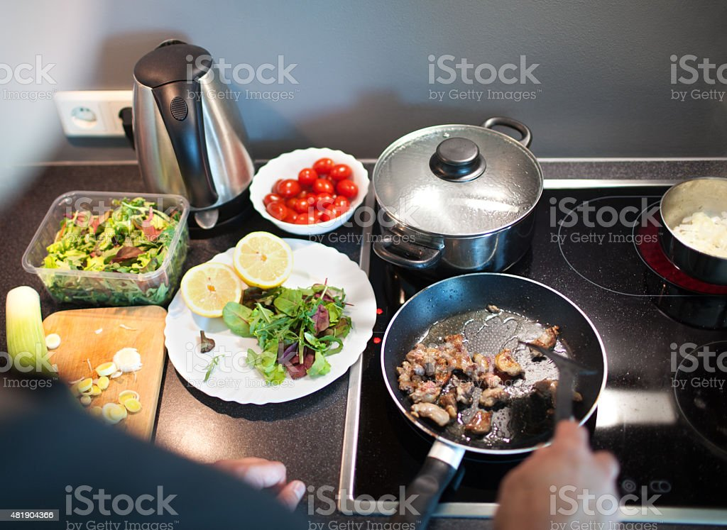 Cooking tasty family dinner at home stock photo