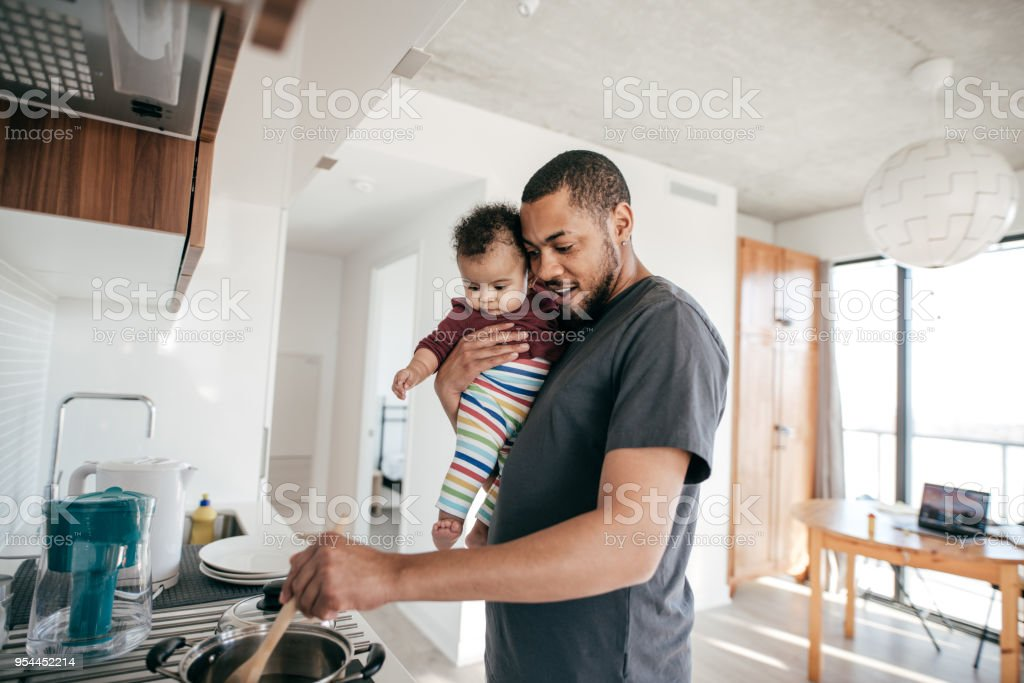 Cooking time with daddy stock photo