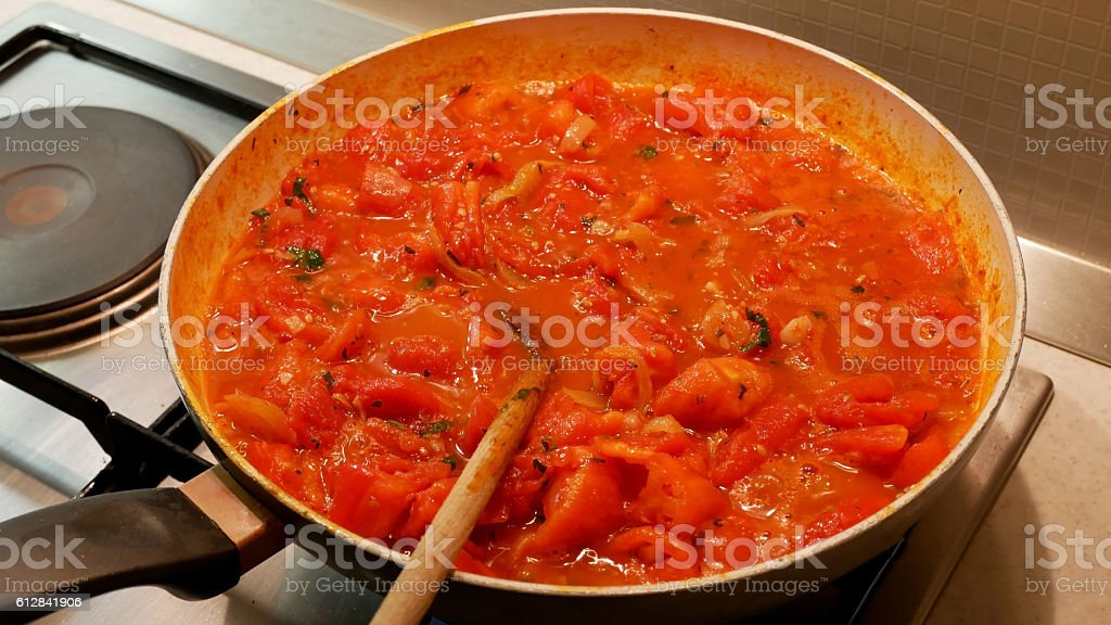 Cooking tomato sauce in pan stock photo
