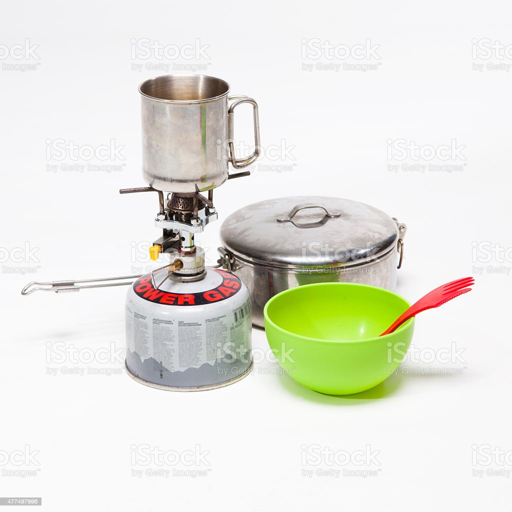 Cooking tourist equipment during camping on white background stock photo
