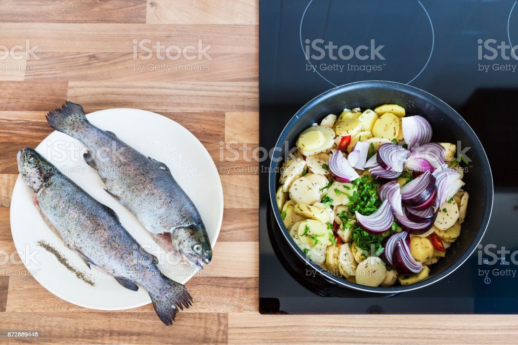Cooking trout royalty-free stock photo