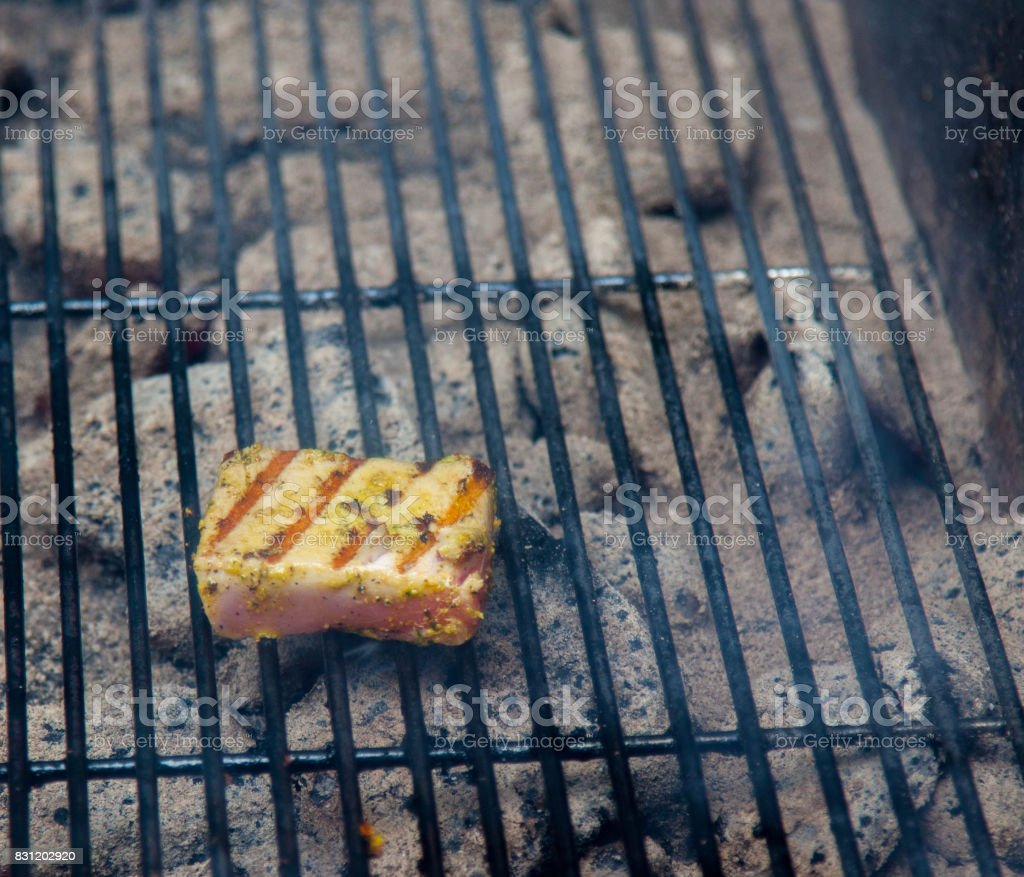 cooking tuna on the grill stock photo