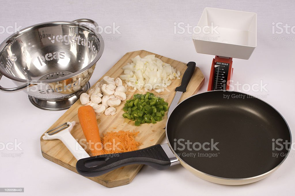 Cooking utensils and vegetables royalty-free stock photo