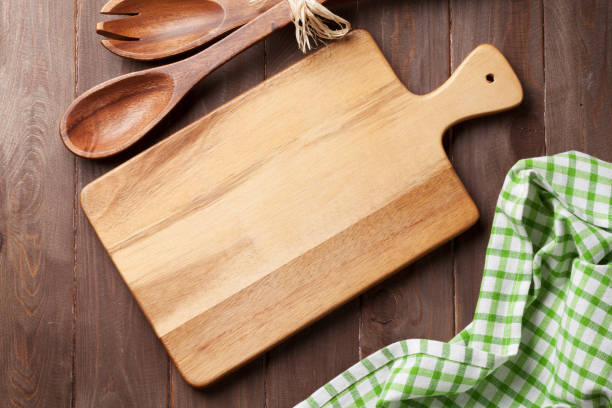Cooking utensils on wooden table stock photo