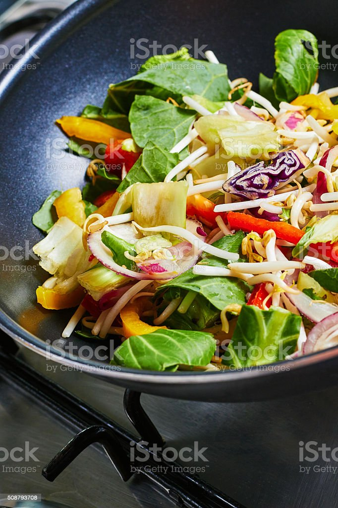 Cooking vegetables in a wok, stir fry stock photo