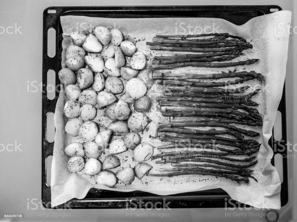 Cooking vegeterian asparagus and patatoe in oven at kitchen in istanbul turkey stock photo
