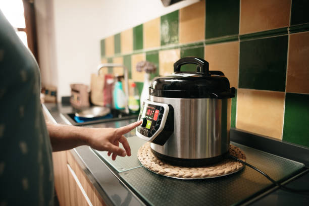 Cooking with an automatic pot stock photo