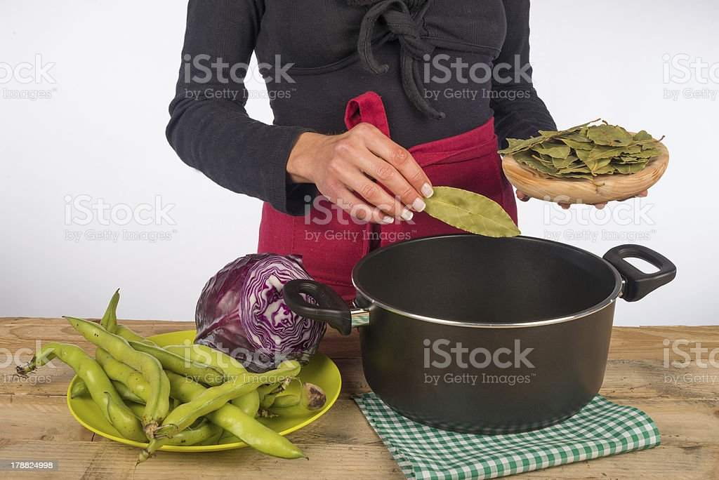 Cooking with bay leaves royalty-free stock photo
