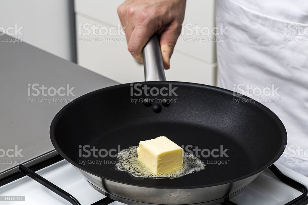 Cooking with butter royalty-free stock photo