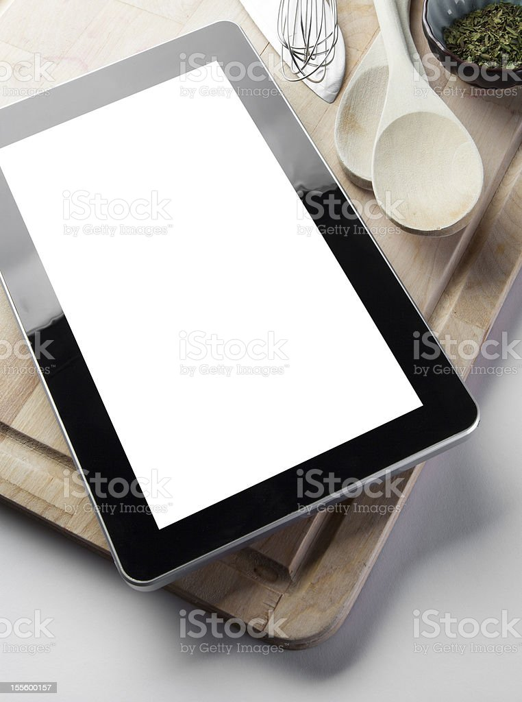 Cooking with Digital Tablet royalty-free stock photo