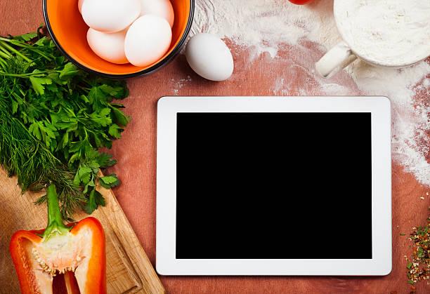 Kochen mit digitalen Tablet – Foto