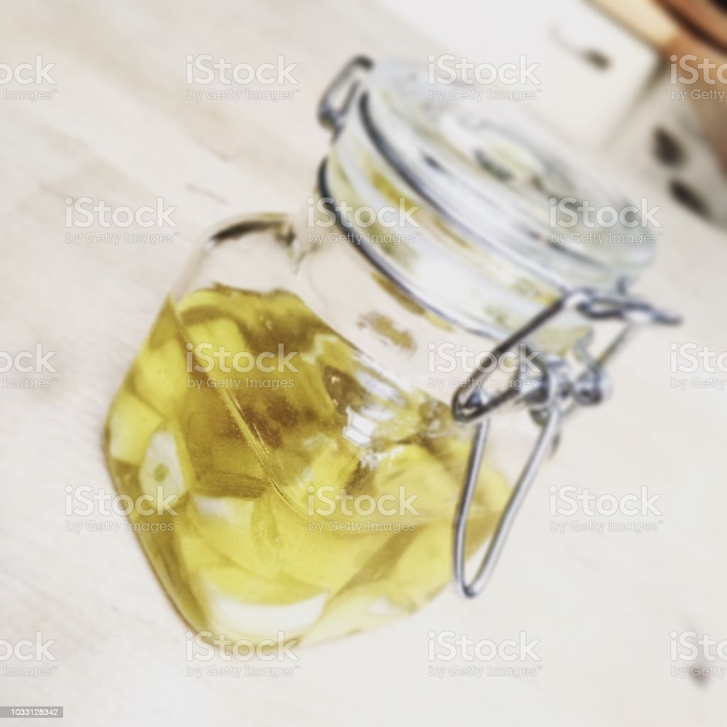 Cooking with garlic oil stock photo