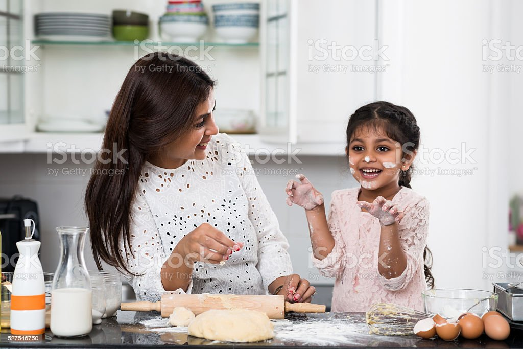 Cooking with mother stock photo