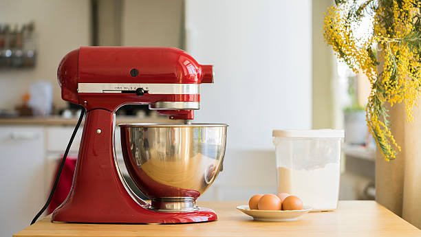 Cooking with red stand mixer Cooking with red stand mixer on light kitchen electric mixer stock pictures, royalty-free photos & images