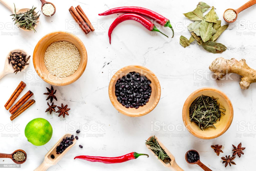 Cooking with spices, salt and pepper on kitchen table background top view royalty-free stock photo