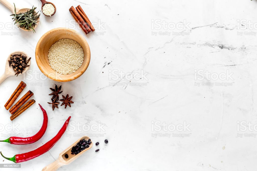 Cooking with spices, vanilla, cinnamon on kitchen table background top view mock-up royalty-free stock photo