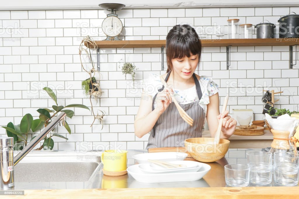Cooking young woman stock photo