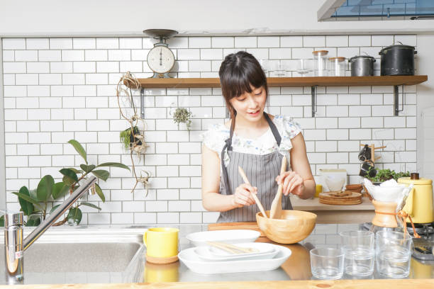cooking young woman - preparing food stock photos and pictures