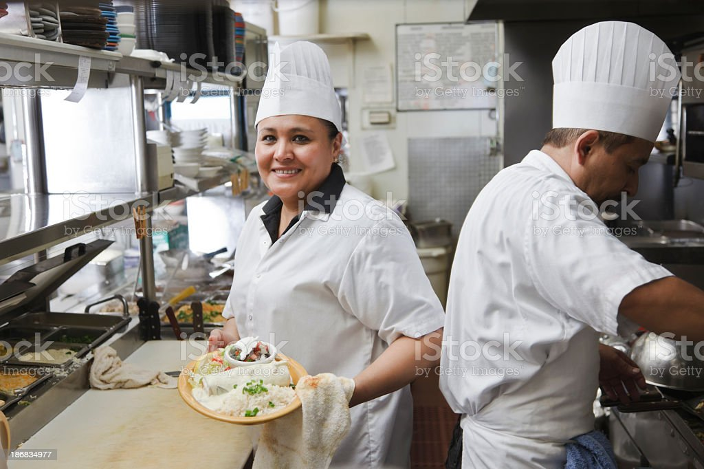 Cooks in a Mexican restaurant kitchen stock photo