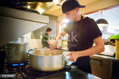 istock Cooks in a small restaurant preparing for service 510130907