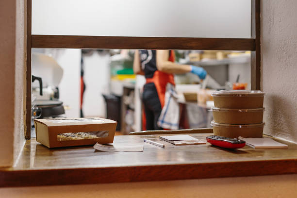 Cooks preparing takeaway food stock photo