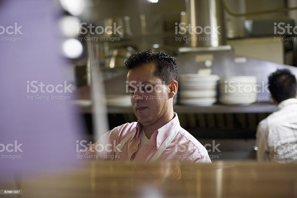 cooks working in kitchen royalty free stockfoto