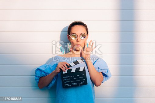 istock Cool Actress Holding Movie Clapper Ready to Film 1170466818