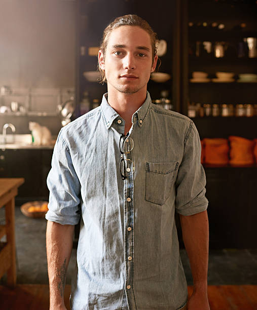 Cool and confident Portrait of a handsome young man standing in his kitchenhttp://195.154.178.81/DATA/i_collage/pu/shoots/804562.jpg man bun stock pictures, royalty-free photos & images