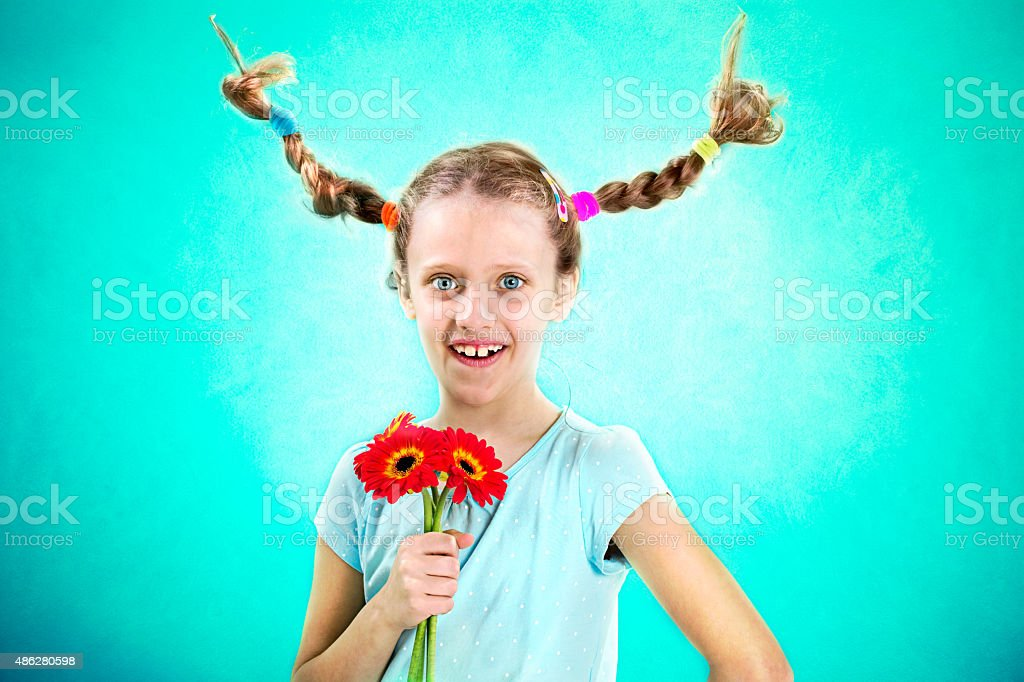 cool and funny girl showing her flowers stock photo