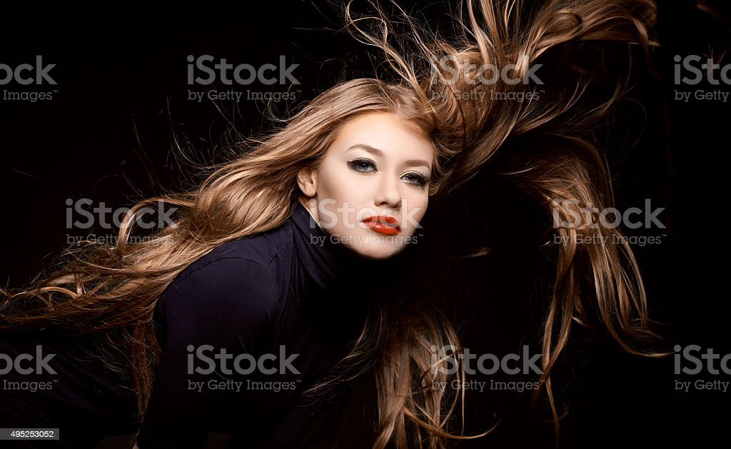 cool attitude of woman with flying hair stock photo