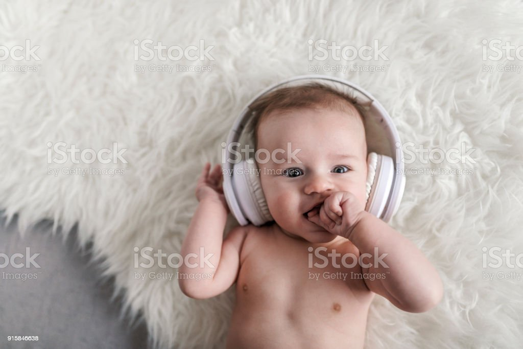 Cool baby listening to music stock photo