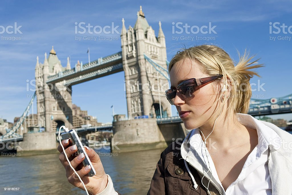 Cool Beautiful Young Woman Listening To Her Ipod In London royalty-free stock photo