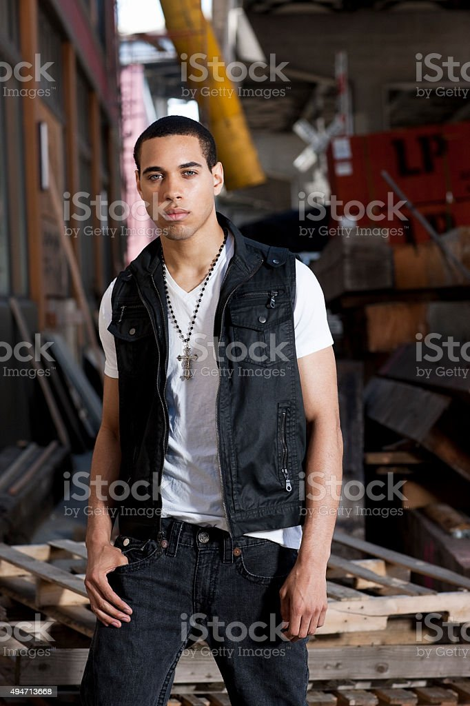 Cool Black Male Standing in Front of Rubbish stock photo