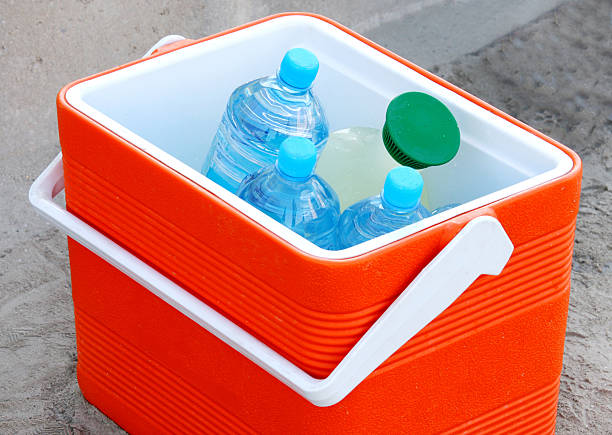 Cool box containing water bottles and juice stock photo