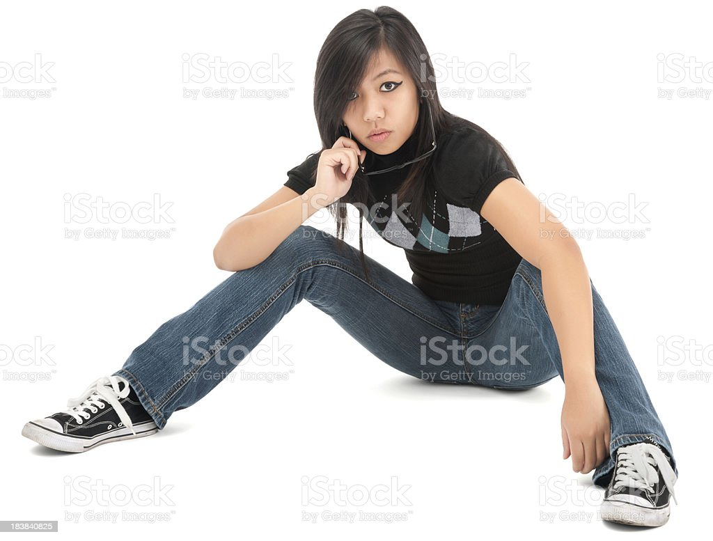 Cool Casual Young Woman Sitting on Floor stock photo