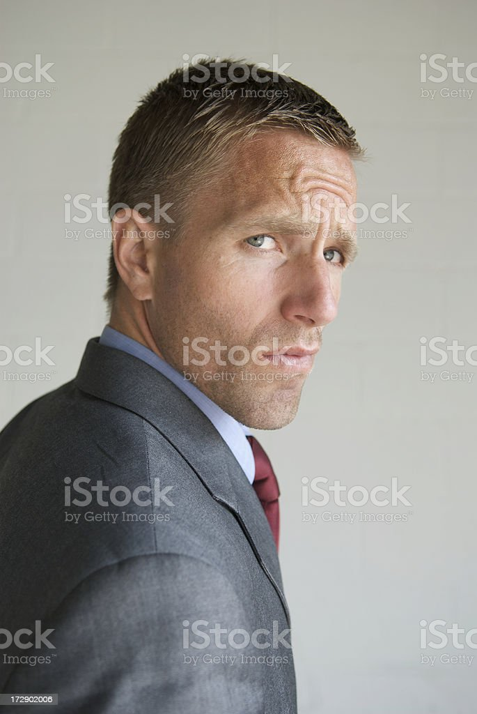 Cool Cocky Businessman Looking at Camera Over Shoulder royalty-free stock photo