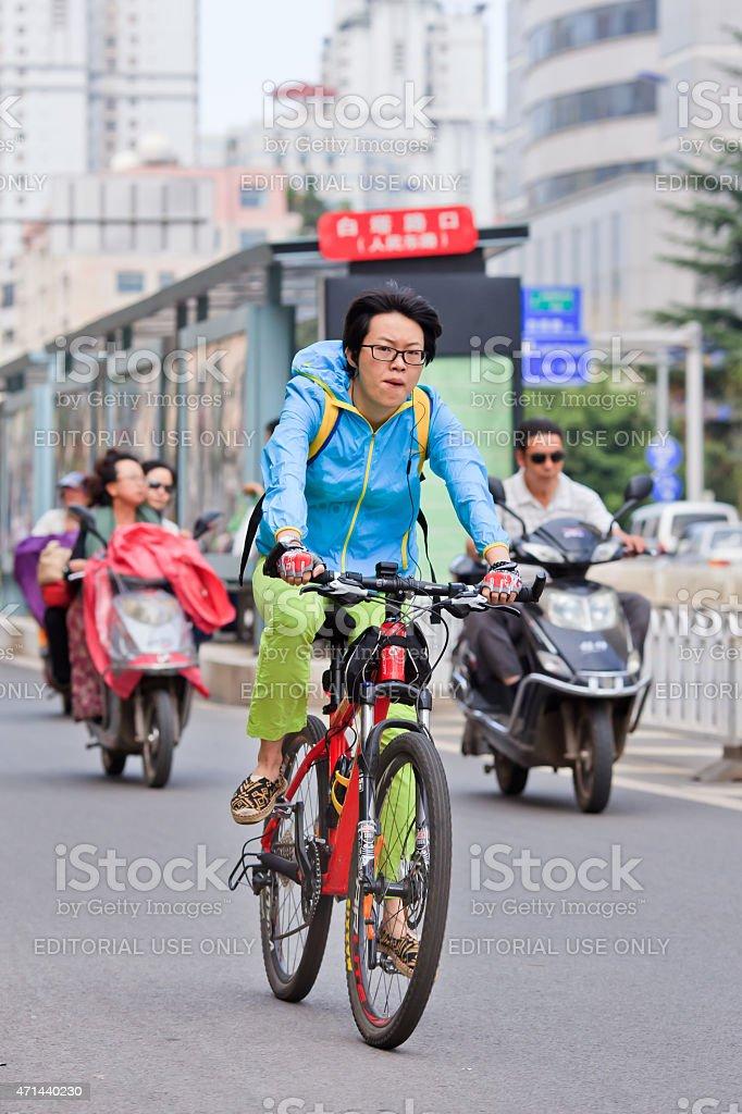 Cool colorful dressed guy on Merida ATB, Kunming, China. stock photo