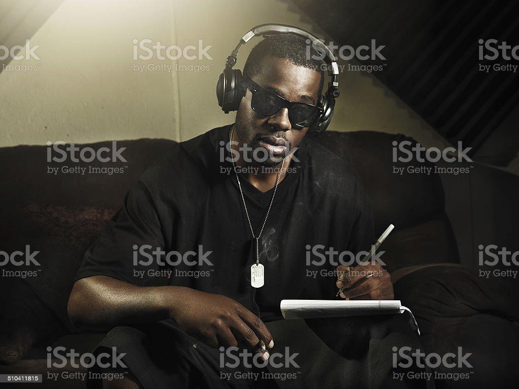 cool dj writing music in recording studio stock photo