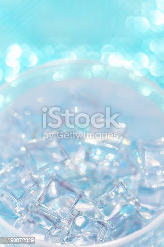 istock Cool drink, close up of ice in glass near pool with tropical colors 1190872329