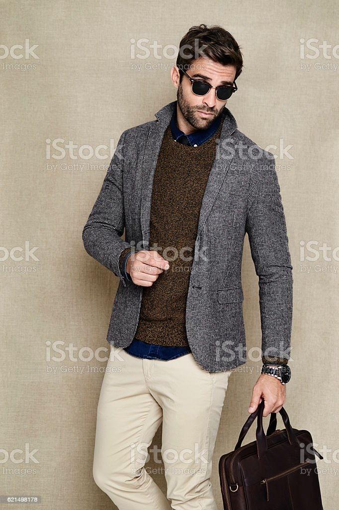 Cool dude in jacket with man bag photo libre de droits