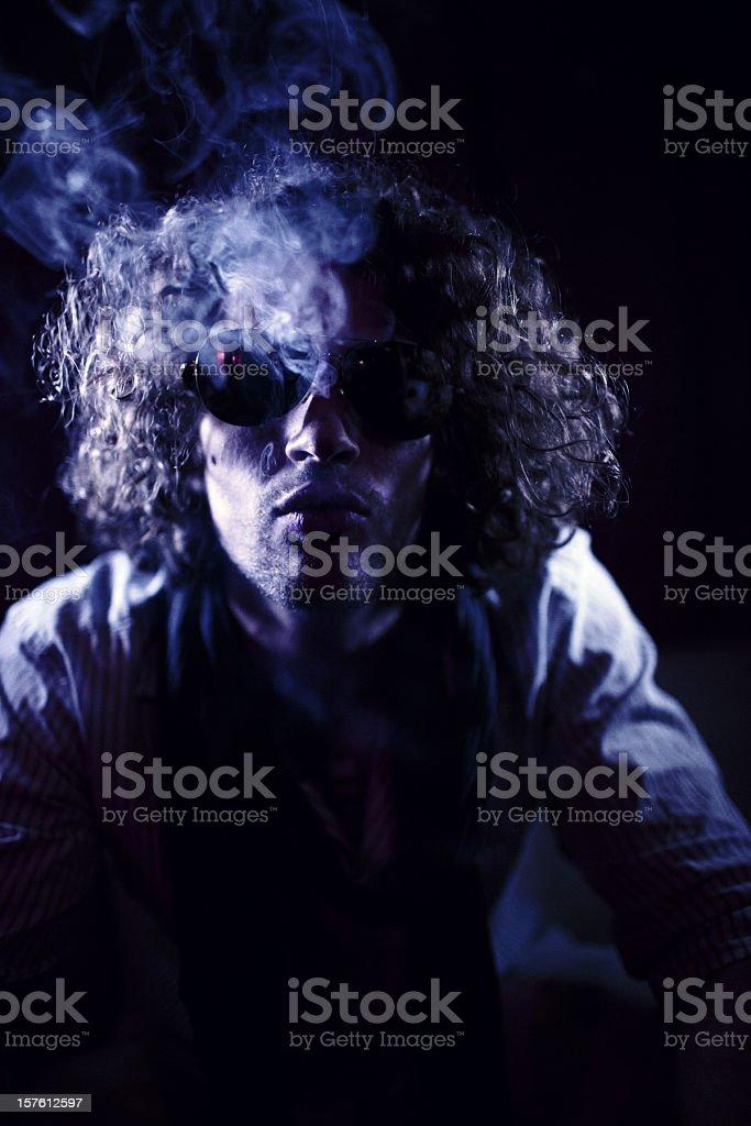 cool dude smoking in a nightclub stock photo
