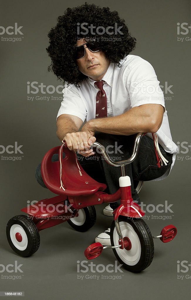 Cool dude wearing afro with tricycle royalty-free stock photo