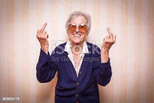 587932042istockphoto cool elder lady making middle finger sign 603833778