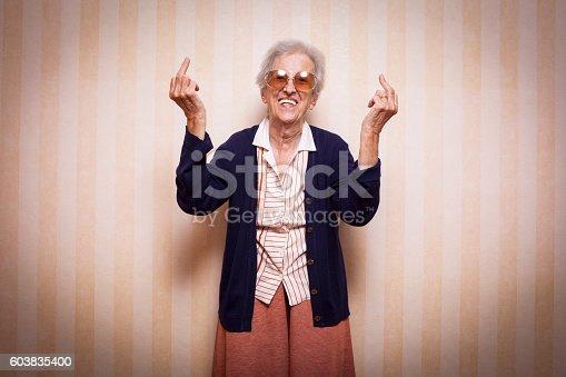 587932042istockphoto cool elder lady making middle finger sign 603835400